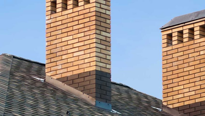 Brick chimneys on the roof